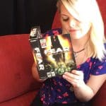 Pretty Blonde Video Game Nerd Holding F.E.A.R. for the PC