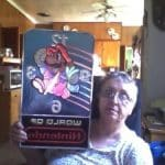 Grandmother Holding World of Nintendo Wall Clock Display for Stores Super Mario 2