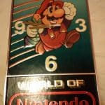 Grandmother Holding World of Nintendo Wall Clock Display for Stores Super Mario 2 3